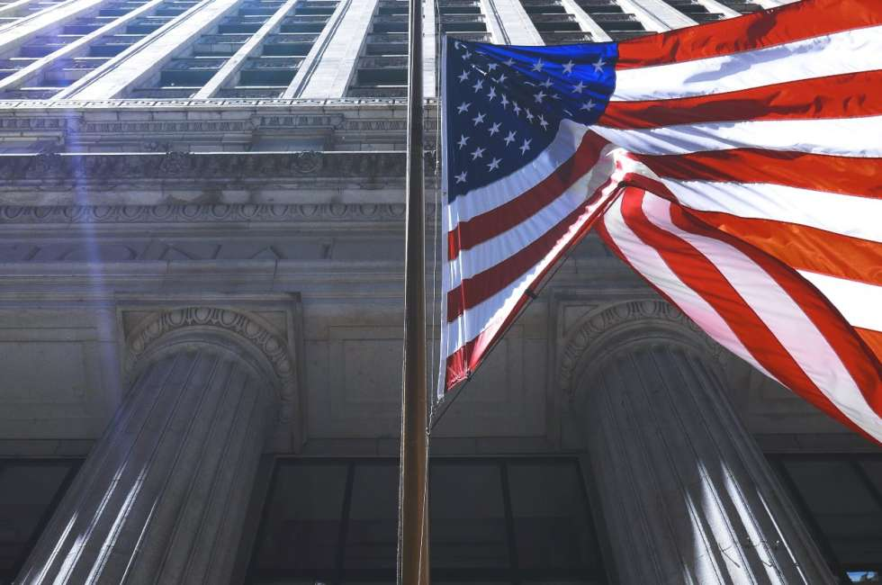 American flag in front of old commerce building